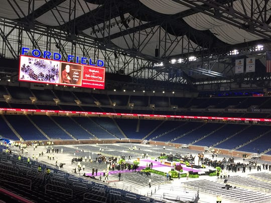 People gather at Ford Field in Detroit on Nov. 18,