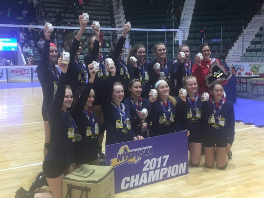 Owego's volleyball team celebrates after winning the program's third Class B state title in five years at the Glens Falls Civic Center.