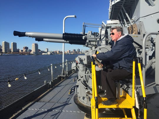 Battleship New Jersey Museun and Memorial Executive Director Phil Rowan turns a crank that controls gun elevation on a newly delivered and refurbished anti-aircraft artillery gun used on the ship during World War II.