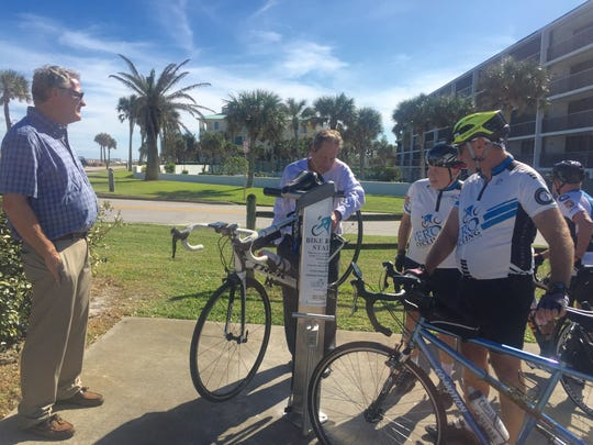 Rob Slazek, left, Charles Sanfors, Pete Nebenfuhr and Hugh Aaron check out the new Bike Workstation  in the southeast corner of the Jaycee Park overflow parking lot in Vero Beach.