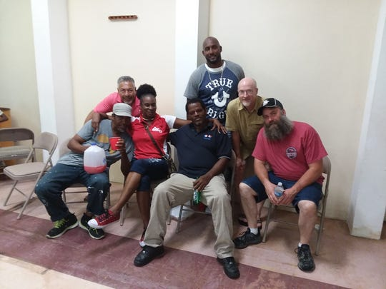 Back row, from left, shows Ernesto Galvez, Camile Reovan and Mike Moutlon, and Steve Howse is seen at the far right. The four Benefis employees traveled to the U.S. Virgin Islands to help after Hurricane Maria.