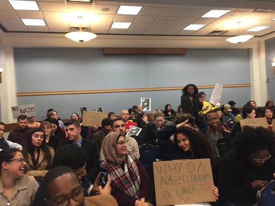 University of Michigan students protest at a Board
