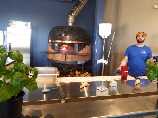 Gennaro Rusciano, co-owner and executive chef at Rusciano's Authentic Taste of Napoli is shown talking about the restaurant's wood-fired brick oven in North Liberty on Nov. 18, 2017.