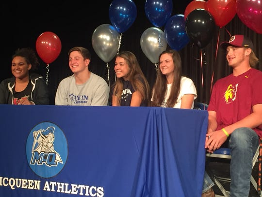 McQueen had five athletes sign for college on Tuesday.