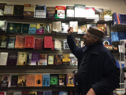 Larry Miles shows some of the books for sale at his