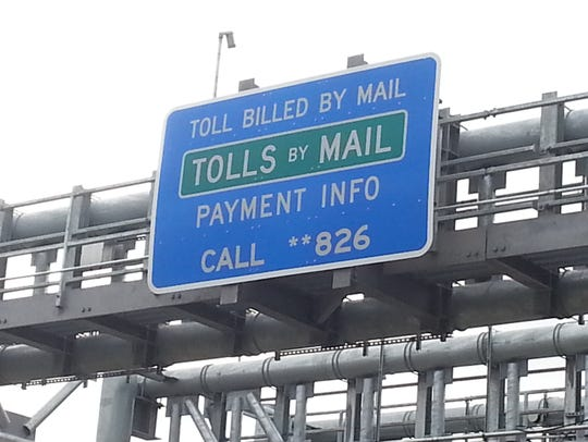 A sign on the electronic toll gantry on the eastbound