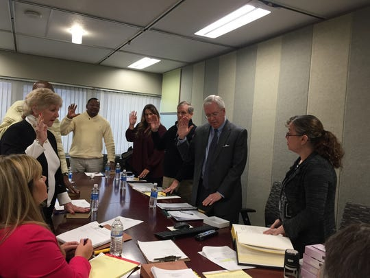 The newly reinstated Wilmington Ethics Commission takes an oath at a meeting on Nov. 14, 2017.