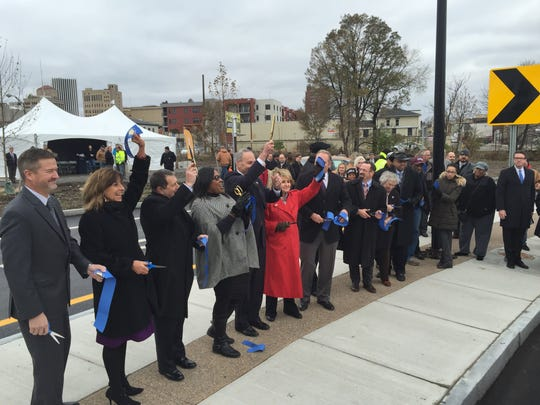 Mayor Lovely Warren and other officials cut the ribbon on Thursday, Nov. 22, 2017, on the Inner Loop East project.