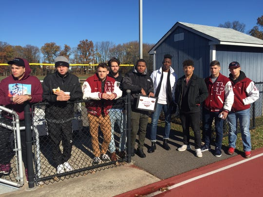 Several current Highland Park students and recent graduates of the high school showed their support for head football coach Rich McGlynn during Thursday's game at Metuchen.