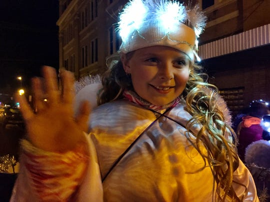 Cheyenne Sharrah, 7, waves from the October Perez Memorial Fund float in the Cheyenne Sharrah, 7, waves from the October Perez Memorial Fund float in the Parade of Lights downtown Saturday of Lights downtown Saturday