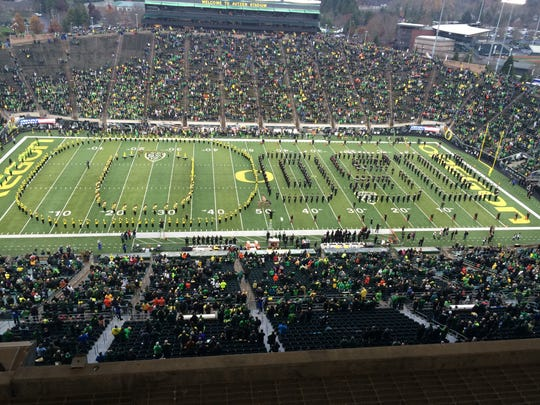 Both the Oregon and Oregon State bands play the national anthem Saturday at the Civil War.
