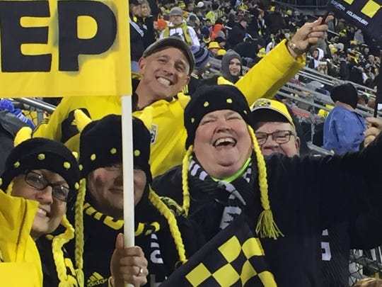 Anita Carroll roots on the Columbus Crew at Mapfre Stadium during a Major League Soccer playoff match.