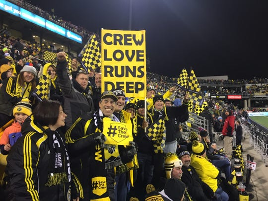 Columbus Crew fans cheer on their team at Mapfre Stadium at a Major League Soccer playoff match.
