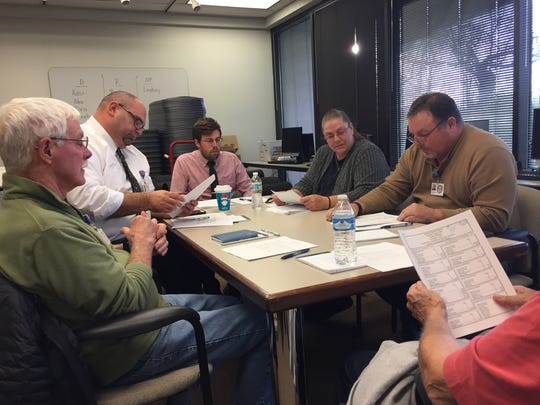 This 2017 file photo shows the Fairfield County Board of Elections certifying elections results. The board is one of 13 Ohio county election boards that have implemented state-mandated election security measures to meet a Jan. 31 deadline.
