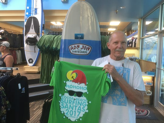 Cocoa Beach artist, Henry Lund, displays the T-shirt