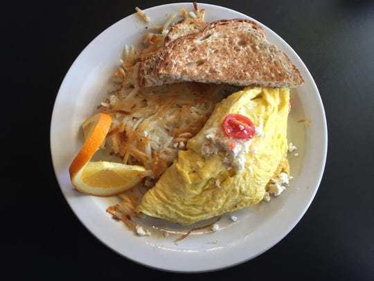 A Greek omelet with hashbrowns and toast at Billy's High Hat Diner in Iowa City on Nov. 22, 2017.