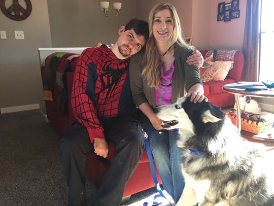 Jennifer Gero, her son, Paul Depagnier, and their dog,