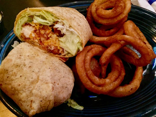 Chicken tender wrap with onion rings at Chumley's.