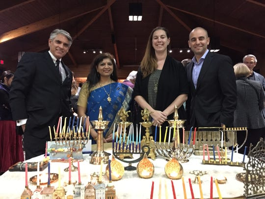 Fred Stella, 63, of Grand Rapids (on the left), spoke Nov. 30 at the Bharatiya Temple in Troy. Stella is with the national leadership council of the Hindu American Foundation and is outreach minister at the West Michigan Hindu Temple in Ada, Michigan. To his right is Padma Kuppa of Hindu American Foundation, Alicia Chandler, president of the Jewish Community Relations Council of metro Detroit/American Jewish Committee, David Kurzmann, executive director of the Jewish Community Council of metro Detroit/American Jewish Committee.