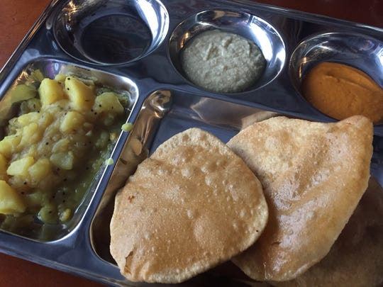 At Maya's South Indian Cuisine, potato masala curry is paired, per tradition, with poori, a puffy, unleavened, deep-fried bread.