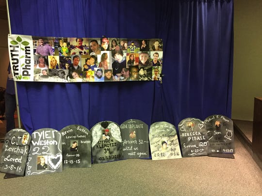 Posters, set up by Truth Pharm and cut to look like tombstones, lined the walls at Tuesday's public hearing on a proposed opioid treatment center. Each had the name of an opioid overdose victim.