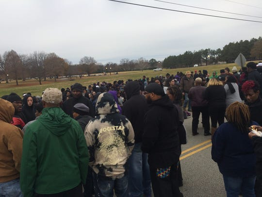 Protesters gather on the edge of campus at Haywood