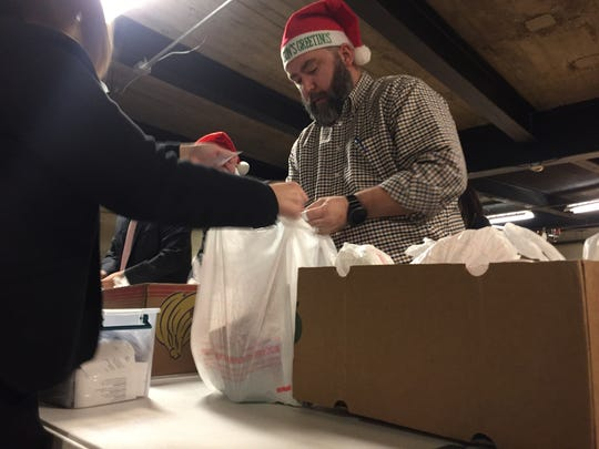 Volunteers gathered Wednesday at Binghamton's East Middle School to pack bags of food for students at risk of hunger over the holidays.