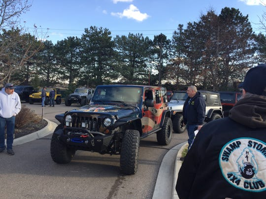 Off-road vehicle fans prepare to leave a meeting Wednesday