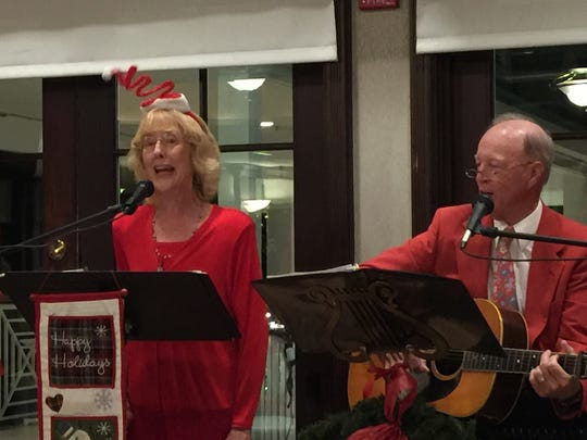 Linda and Alan Sandlin entertained with a lively music performance and holiday sing-a-Long.
