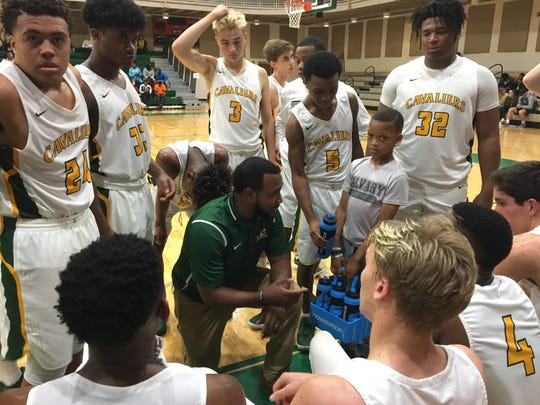 Calvary coach Victor Morris makes a point to his team during a timeout against Byrd.