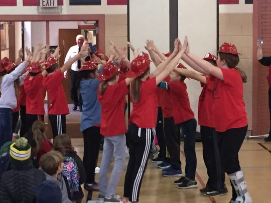 "McKinley Elementary students made a ""human tunnel"" for Chief Rob Ugaste as he entered the gym, where the surprise thank you assembly was held."