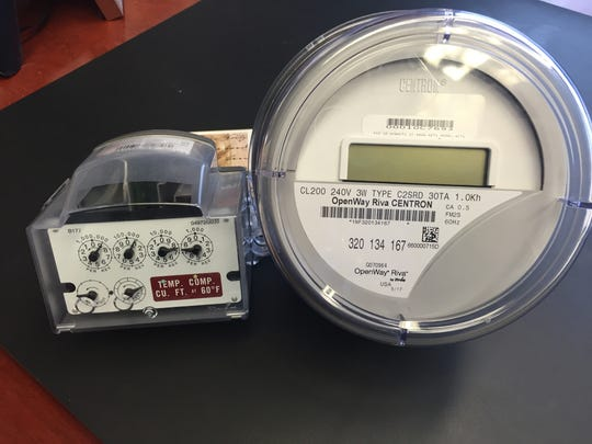 "At right is the ""smart meter"" Vectren will be installing for customers across its service area in 2018. At right is an encoder receiver transmitter, which those with natural gas meters also will receive."