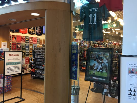 Carson Wentz memorabilia inside a display at AB Sports at the Concord Mall