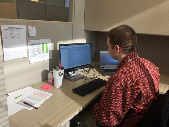 Matt Norman works at his desk at The Precisionists,