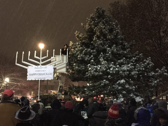 A crowd gathered Tuesday evening at a menorah-lighting