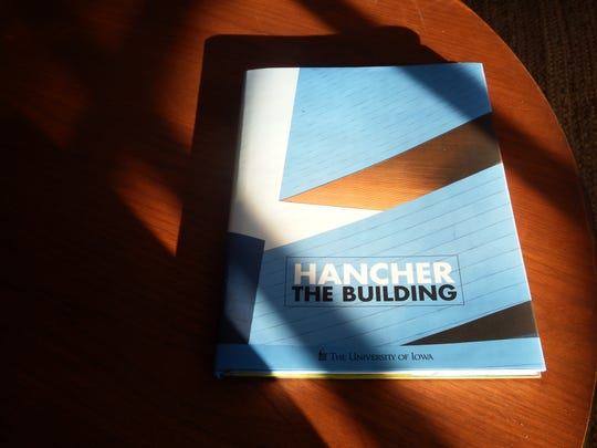 "University of Iowa Press's ""Hancher: The Building"" by Jean Florman is shown on Dec. 12, 2017."