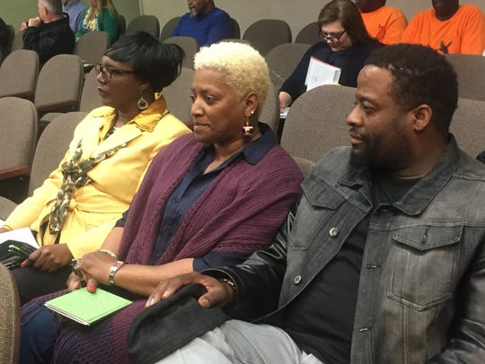 Small business owner Yolanda Pitts, center, spoke in