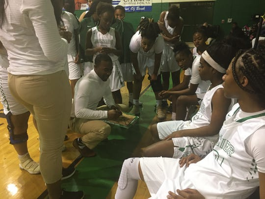 Bossier coach DeShawn Williams goes over a play with the Lady Kats during Tuesday's game with Ouachita.