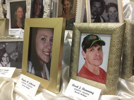 The names and photographs of 35 Michigan men women and children lost to gun violence were displayed on a table at a candlelight vigil Dec. 10, 2017 at St. Paul Episcopal Church in Brighton. Among them is Derek Flemming, a 42-year-old Howell father shot to death in a road rage incident in 2014.