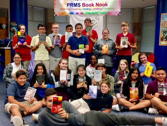 Students at Pine Ridge Middle School enjoy books they