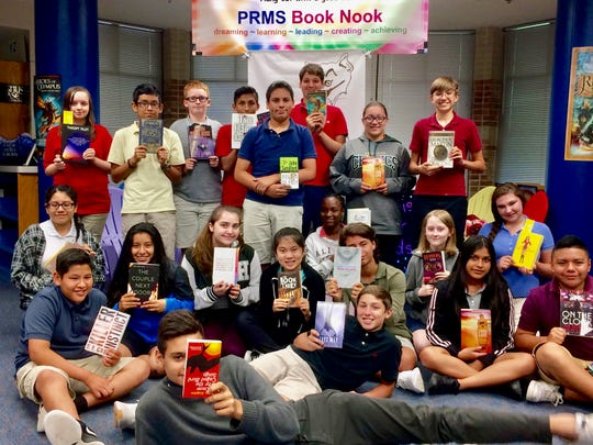 Students at Pine Ridge Middle School enjoy books they received with help from K is for Kids.