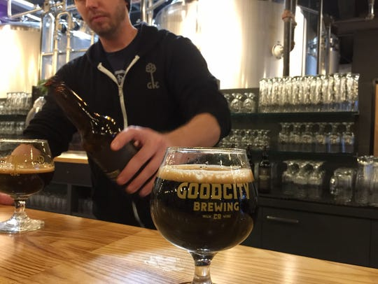 Good City co-founder and brewmaster Andy Jones pours