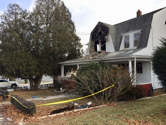 A 61-year-old woman died Tuesday in a Butler house
