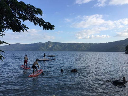 Ford and Morgan Williams paddle on Laguna de Apoyo