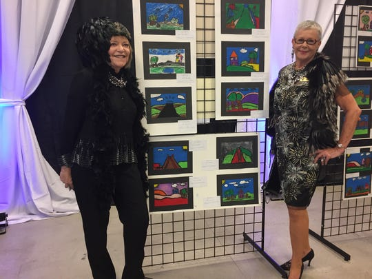 Co-Chairs Alaina Bixon (editor and publisher) and Suzanne Fromkin, with TFT students' art exhibition