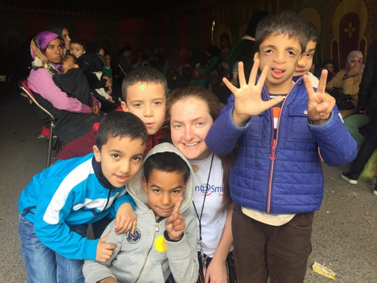 Rose Doherty, a senior at Mount Saint Mary Academy in Watchung, is pictured with some of the boys she met during the first day of screening on Nov. 24 during her medical mission trip in Safi, Morocco with Operation Smile.