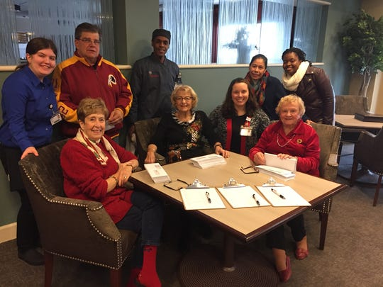 Front row, from left:Resident Chris Stoddard, resident Rosemary DeWitt, concierge Caitlin Sendell and resident Ann Cafaro; back row, from left:waitress Ashley Clausen, housekeeping utility worker George Butt, prep cook Reginald Walker, prep cook Celia Federkiewicz and care associate Nanayaa Owiredua.