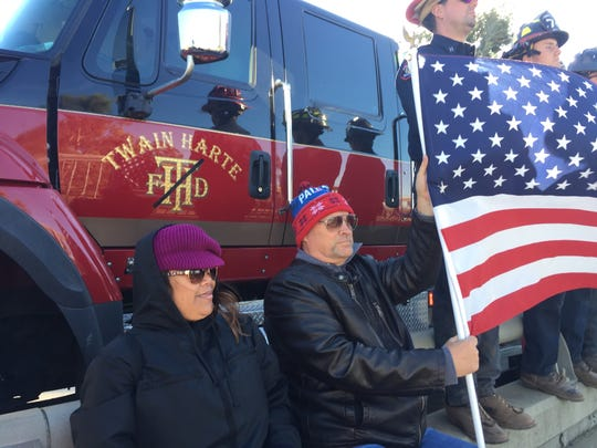 Jerry Gulsvig of Oxnard waits on the Del Norte Boulevard overpass for the procession for Cal Fire's Cory Iverson