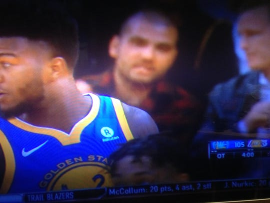 Joey Votto watches a Lakers-Warriors game on the night Kobe Bryant's numbers were retired in 2017.