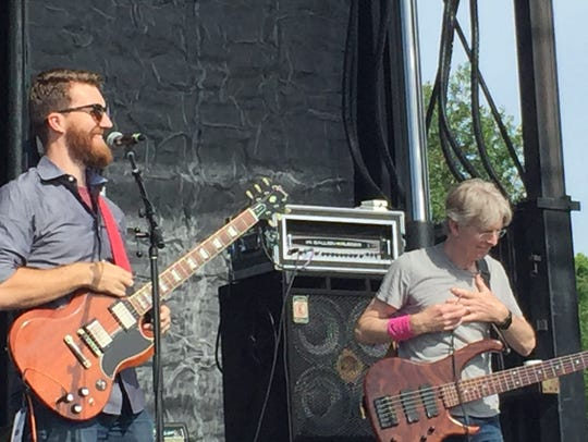 Phil Lesh of the Grateful Dead acknowledges the hearty cheers of the crowd as he sits in with Midnight North, the band led by his son, Grahame Lesh, during a concert at Waterfront Park in Burlington, Vermont.